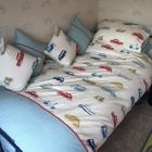 Duvet cover with matching pillow cases and cushions.