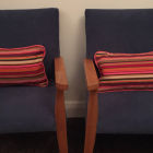 Two cute matching piped cushions for children's chairs