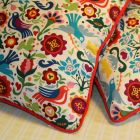 Cushions with bright red contrast piping.