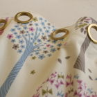 Pretty eyelet headings in matt gold