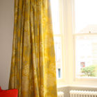 Double pinch pleat lined curtain open