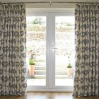Curtains open with triple pinch pleat heading