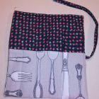 Cutlery roll with napkin