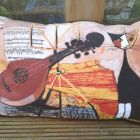 "Rosina Wachtmeister cat cushion. 15X23"" Linen with black cotton piping and back. £40 including feather pad."